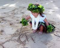 Hula girl playing in the sand