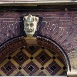 """Haarlem Man Building Detail 1"" by kphotos"