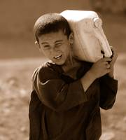 Afghan Child Carrying Water