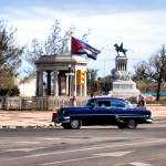 """Blue Ford drives by the Cuban Flag"" by IMAX007"