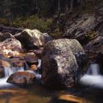 """Boulder Strewn Stream Waterfalls"" by FallingSilver"