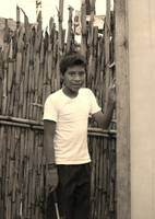 Boy infront of bamboo
