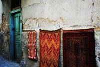 Turkish Rugs By A Blue Door