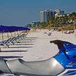 """Fort Meyers Beach Toys and Umbrellas"" by kphotos"