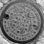 """New Orleans Water Meter Cover (Black & White)"" by NOLAlphabet"