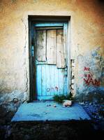 Old Wooden Door In Yellow And Blue