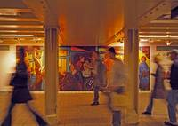 Subway commuters and mural