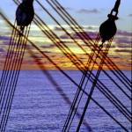 """South Pacific Sunset Through the Rigging of Mallor"" by jonkjaerulff"