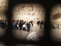 Western wall through fence