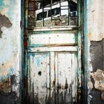 """Door With Reflection In Flaking Paint"" by joshuaphotography"
