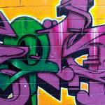 """Graffiti in green and mauve"" by abraxas35"