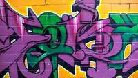 Graffiti in green and mauve