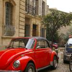 """Shiny red bug in Avignon"" by charlablue"