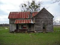 Old Texas Farm House With Texas Flag