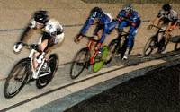 Track cyclist going into Final Turn