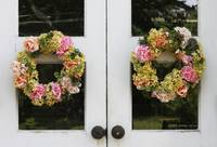 Floral Wreaths on White Doorway