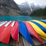 """Colorful canoes at Lake Moraine, Banff"" by canbalci"