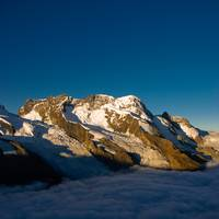 Breithorn above the clouds in early morning