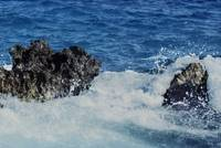 Waves Spashing On Coral Rock