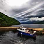 """Blue Boat in Harbour of Scottish Loch"" by IainGordon"