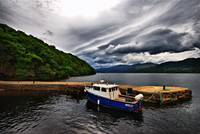 Blue Boat in Harbour of Scottish Loch