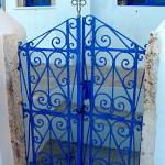"""Blue Gate in Oia"" by meganmeetsworld"