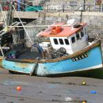 """Blue trawler in Tenby harbour"" by petersandbach"