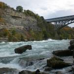 """Niagara Whirlpool rapids with Whirlpool Bridge 2"" by evoken"