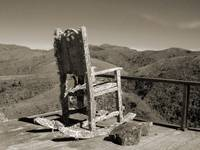 Old chair overlooking mountains