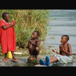 """Kids At Lake Kivu Hotsprings"" by MellisaFernPhotography"