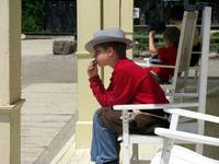 Little boy playing the harmonica