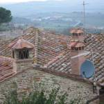 """Across the rooftops of Panicale to Passignano"" by anneberrysmith"