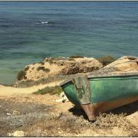 Moored Boat on the Shore Art Prints & Posters by PhotoStock Israel