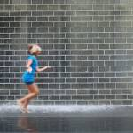 """Girl running at Crown Fountain Millennium Park"" by nicelysighted"