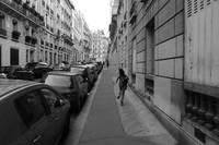 Child Running on Paris Street