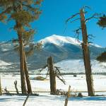 """Sunset Crater Ranch with Snow"" by BobFikePhoto"