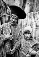 father and child at pisac's market