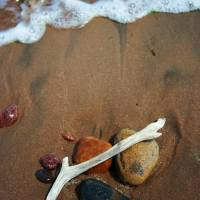 Beach stones Art Prints & Posters by Allan Price