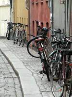bikes down a narrow street