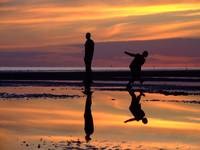 ANTHONY GORMLEY STATUES, PLAYFUL SUNSET