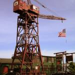"""Museum of Industry Crane and Flag"" by Artsart"