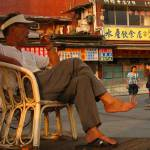 """""""Man in red chair, Taipei"""" by HoriaComan"""
