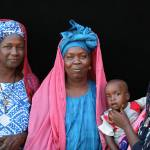"""Pulaar Women with Baby"" by AndreaMoorePhotography"