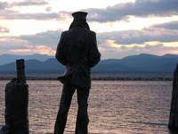 Sailor in shadow on Lake Champlain