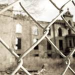 """Abandoned Building through Fence"" by WWanderlust"
