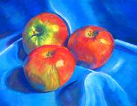 Apples on blue cloth