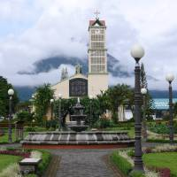 La Fortuna Church with Arenal Volcano Behind Art Prints & Posters by Bruce Cardner