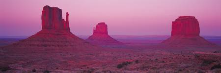 Monument Valley Bathed in Purple and Red Light