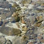 """rocks in the water 2"" by photographsaroundtheworld"