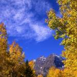 """Maroon Bells, Clouds and Aspen Trees"" by mikenorton"